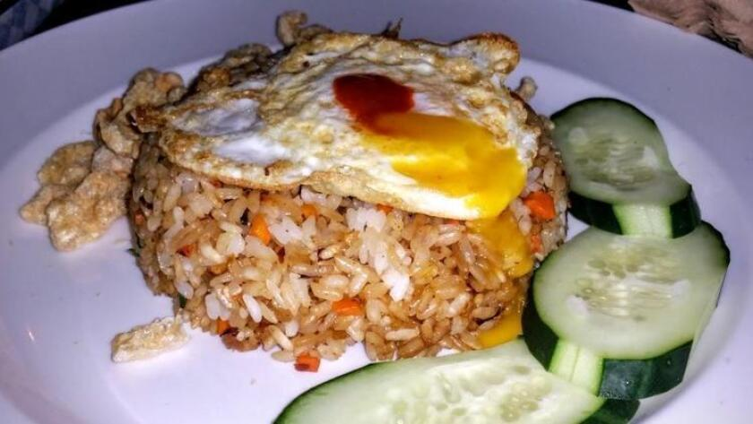 Nasi Goreng, also known as Balinese style fried rice with an egg on top, served at Single Fin Surf Grill in Mission Beach. (Amy T. Granite)