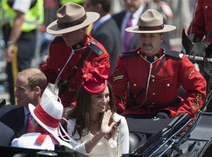 The Duke and Duchess of Cambridge arrive on Parliament Hill in a landau for Canada day celebrations in Ottawa on Friday, July, 1 2011. (AP Photo/The Canadian Press, Pawel Dwulit)