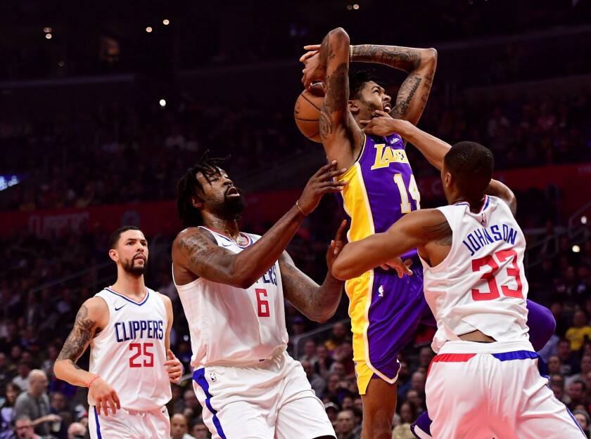 LOS ANGELES, CA - NOVEMBER 27: Brandon Ingram #14 of the Los Angeles Lakers is fouled by Wesley Johnson #33 of the LA Clippers as he drives to the basket during the first half at Staples Center on November 27, 2017 in Los Angeles, California.