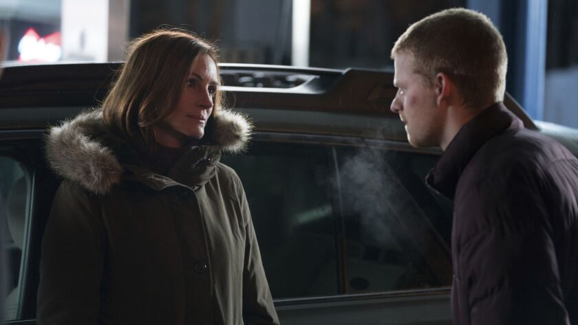This image released by Roadside Attractions shows Lucas Hedges, right, and Julia Roberts in a scene