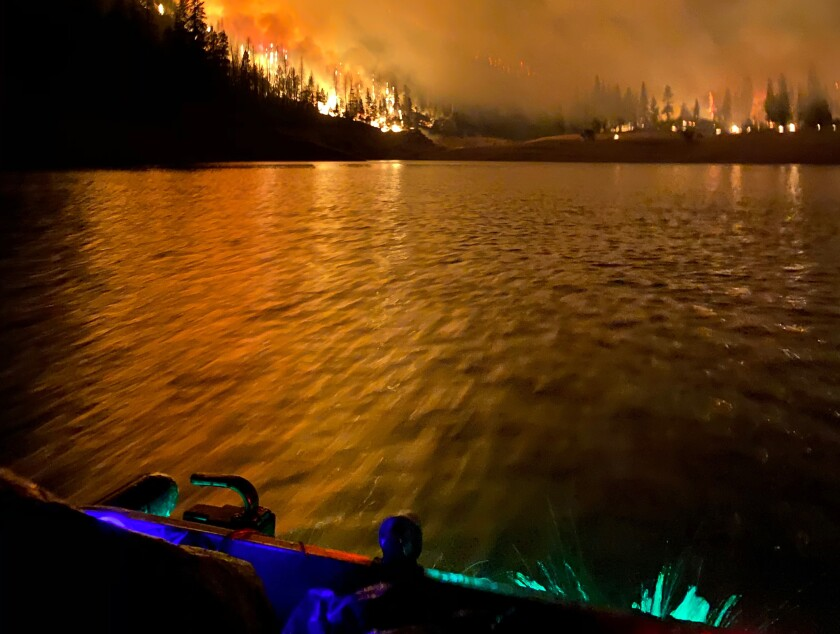 The view from Saul Gonzalez' boat of the Creek fire surrounding Mammoth Pool Reservoir