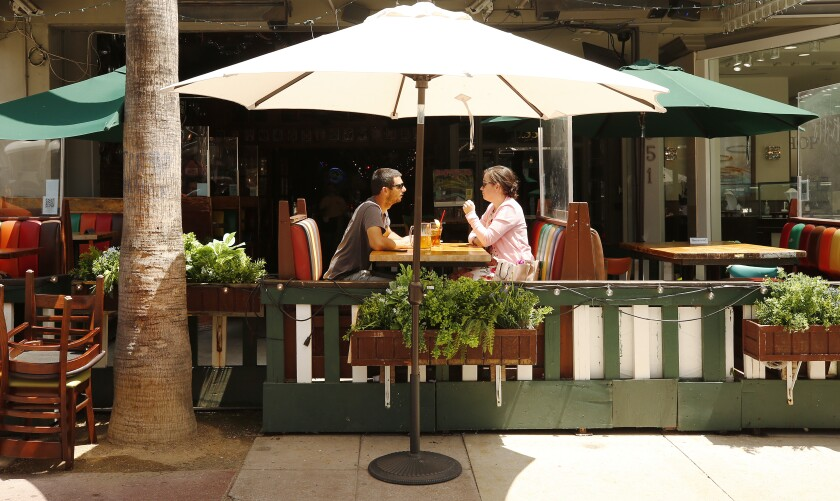 Patrons sit outside dining