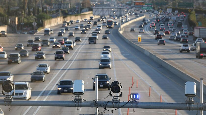 Cameras and electronic sensors stand over the express lane south of the Slauson Avenue transit station on the 110 Freeway.
