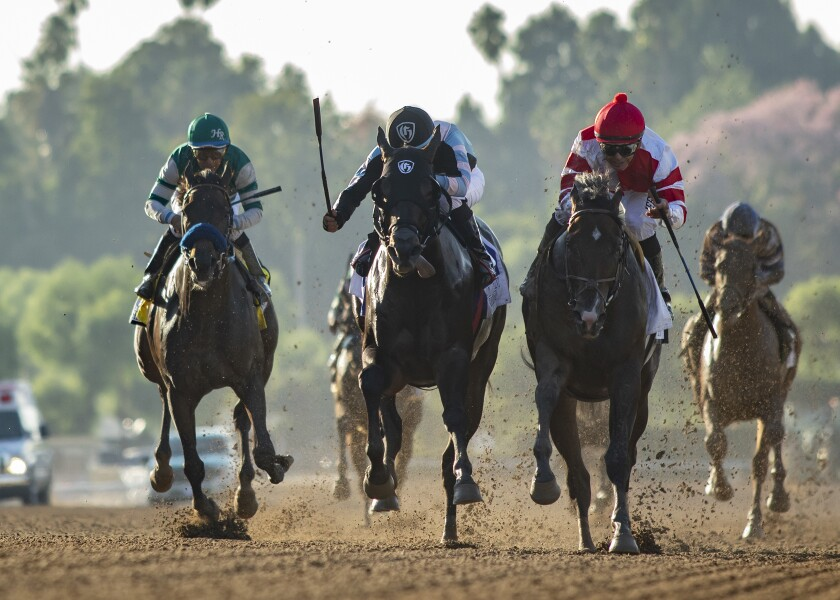 Omaha Beach and jockey Mike Smith, right front, overpower Shancelot, second from left, and Flagstaff, left, to win the Grade I, $300,000 Santa Anita Sprint Championship horse race on Saturday in Arcadia.
