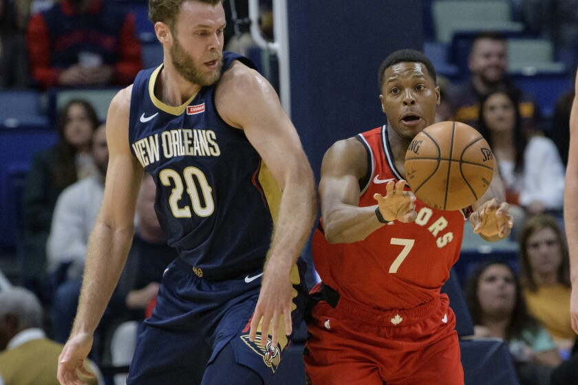 Toronto Raptors guard Kyle Lowry (7) passes the ball away from New Orleans Pelicans forward Nicolo Melli (20) during the first half of an NBA basketball game in New Orleans, Friday, Nov. 8, 2019. (AP Photo/Matthew Hinton)