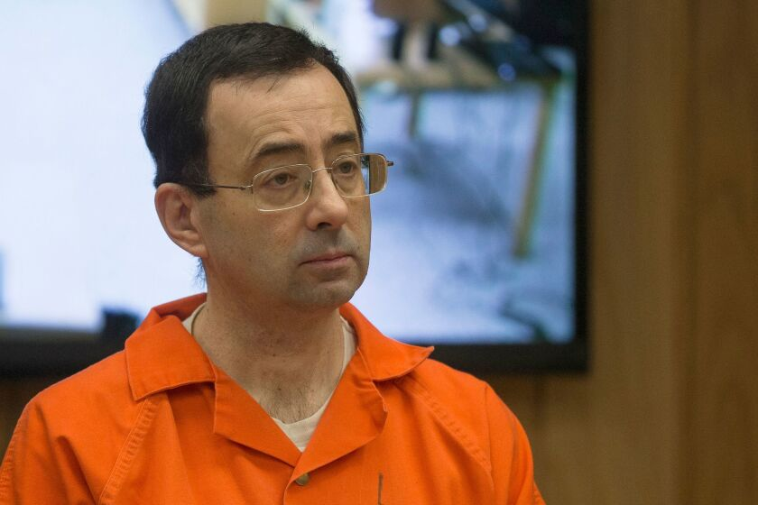 Former Michigan State University and USA Gymnastics doctor Larry Nassar appears in court for his final sentencing phase in Eaton County Circuit Court in Charlotte, Mich., on Feb. 5, 2018.