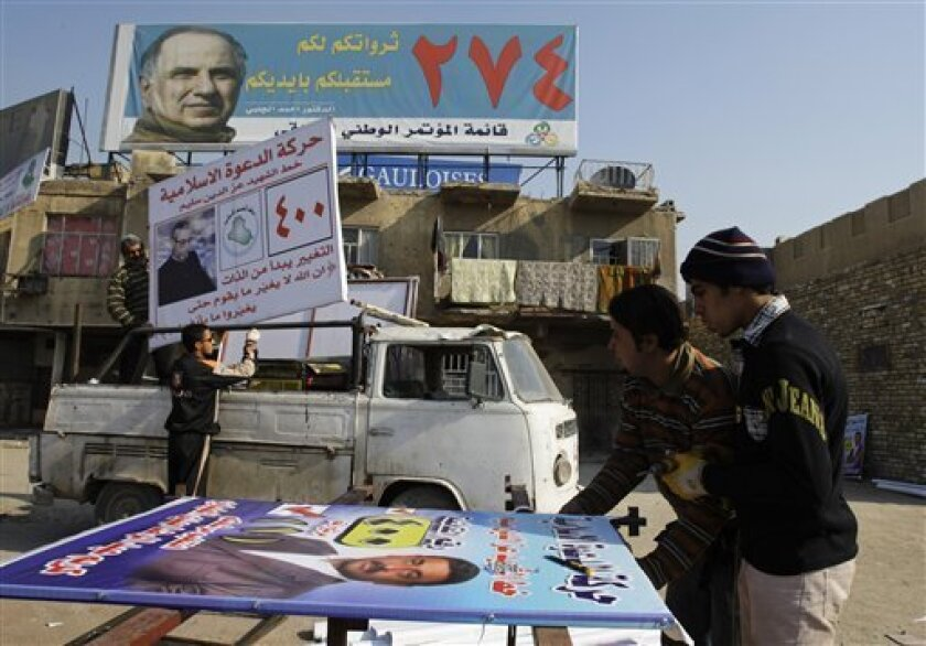 Workers prepare to install an election banner in Baghdad, Iraq, Monday, Jan. 19, 2009. Iraq's provincial elections are scheduled for January 31, 2009. (AP Photo/Karim Kadim)