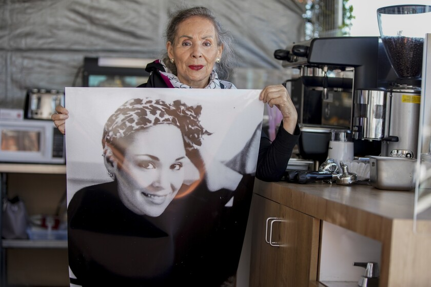 Carmen Saucedo, 76, holds up a photo of her late, daughter Paulina Baeza