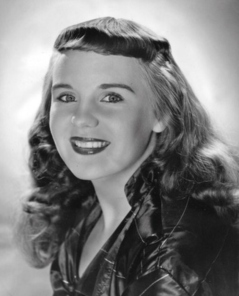 """Molly Bee had her first hit, """"I Saw Mommy Kissing Santa Claus,"""" at 13, then appeared on """"Hometown Jamboree"""" and """"The Tennessee Ernie Ford Show""""."""