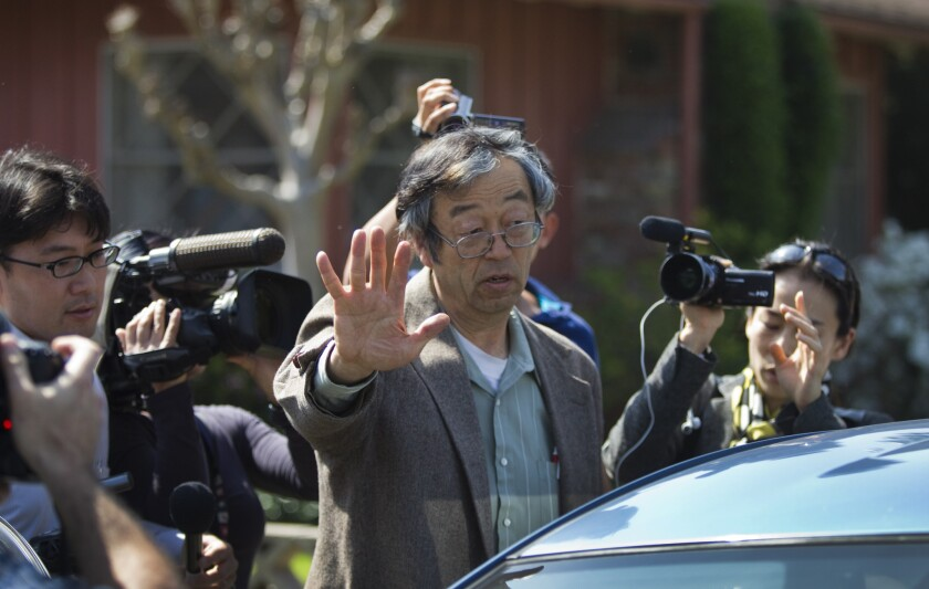 TEMPLE CITY, CA-MARCH 6, 2014: Journalists surround Satoshi Nakamoto, the mythical Bitcoin creator, as he walks to his car from his home in Tempe City Thursday, March 6, 2014. (Photo By Allen J. Schaben / Los Angeles Times)