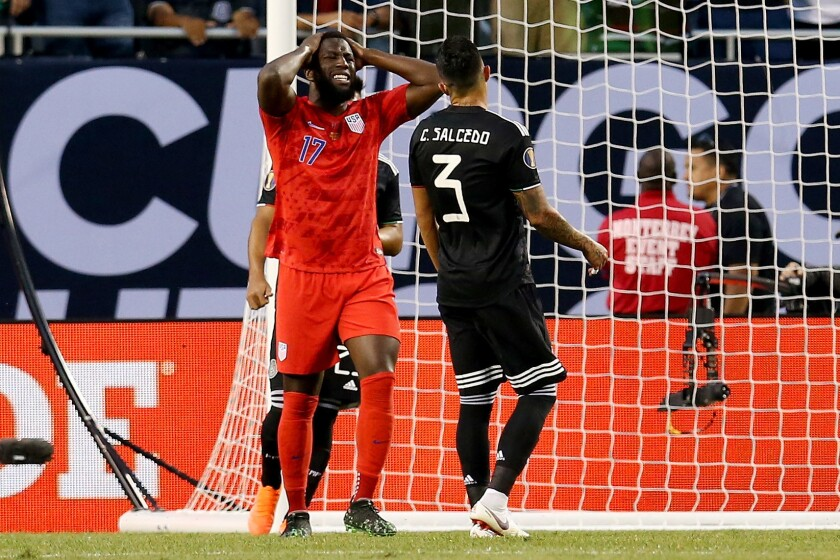 U.S. striker Jozy Altidore reacts after missing a shot against Mexico in the Gold Cup final on July 7.