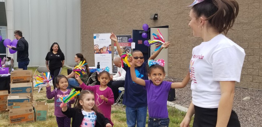 Alexandra Hill looks back at her students after teaching cheerleading at the Month of the Military Child celebration, an annual event coordinated by Strong Families, Strong Children, at the Los Alamitos Joint Forces Training Base in April 2019.