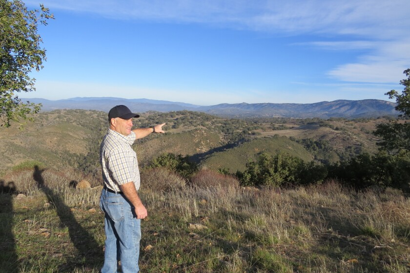 From his backyard, Julian resident Brian Kramer looks out over the Hoskings Ranch property to the north where 24 luxury homes had been proposed.