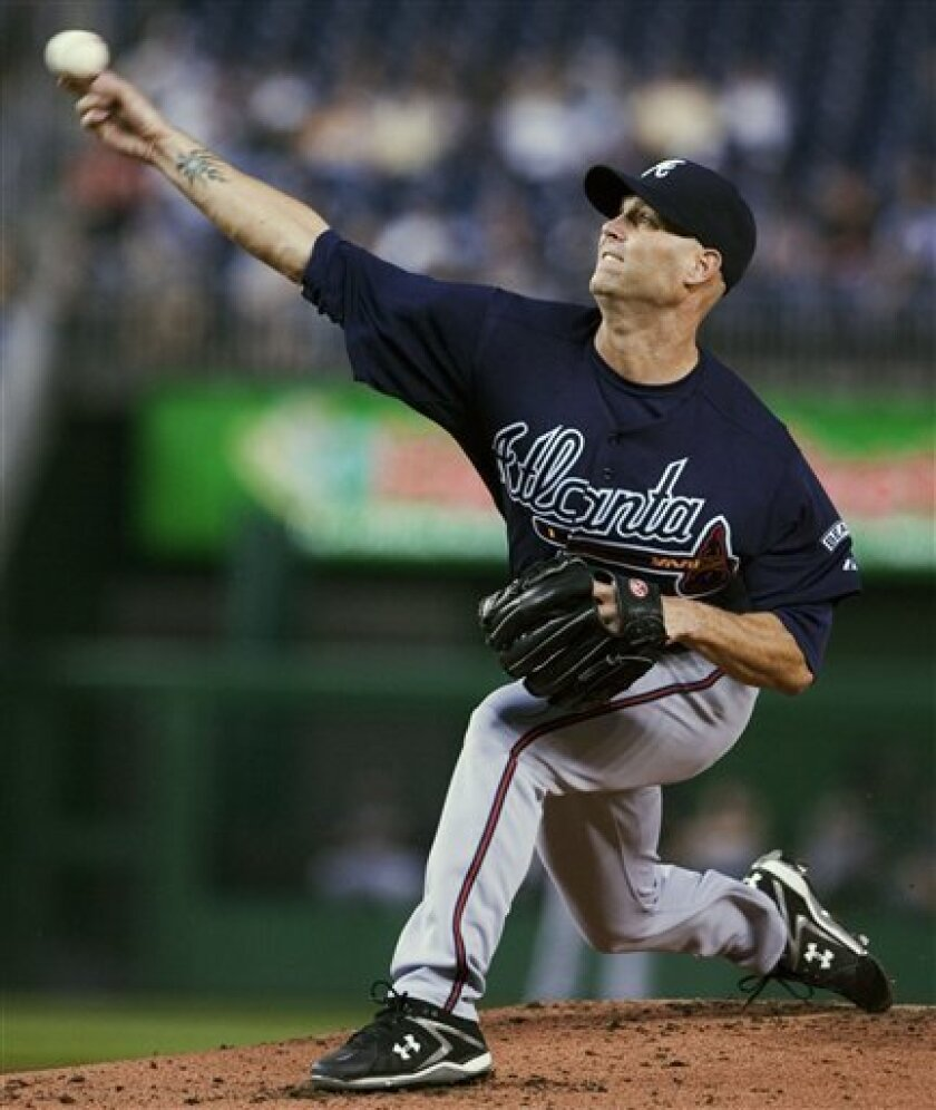 Atlanta Braves starter Tim Hudson delivers a pitch during the first inning of a baseball game against the Washington Nationals, Friday, April 11, 2008, in Washington. (AP Photo/Manuel Balce Ceneta)