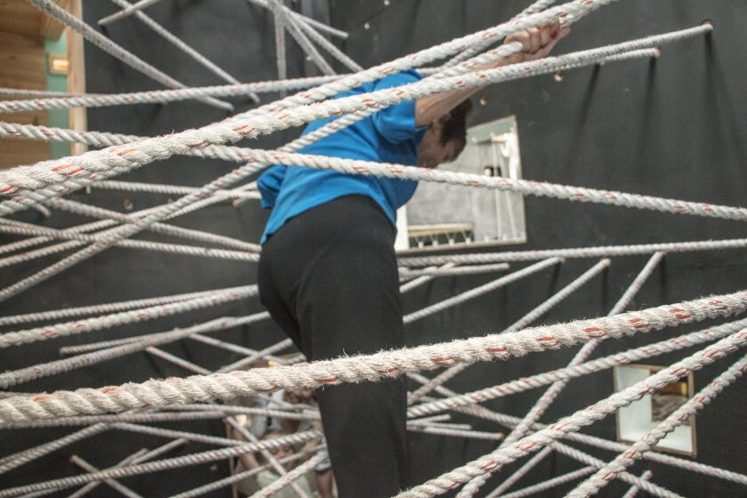 Writer Lonnie Burstein Hewitt on the ropes, negotiating a two-story spider web.