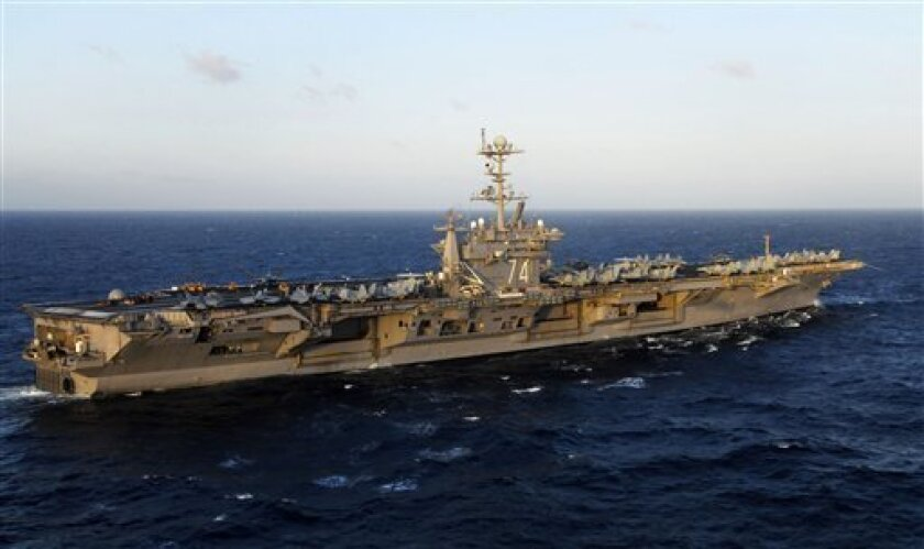 In this image provided by the U.S. Navy the aircraft carrier USS John C. Stennis is shown at sea in the Pacific Ocean on Nov. 14, 2009. A F/A-18C Hornet jet fighter's engine exploded and caught fire Wednesday March 30, 2011 as it prepared to take off from the aircraft carrier off California, injuri