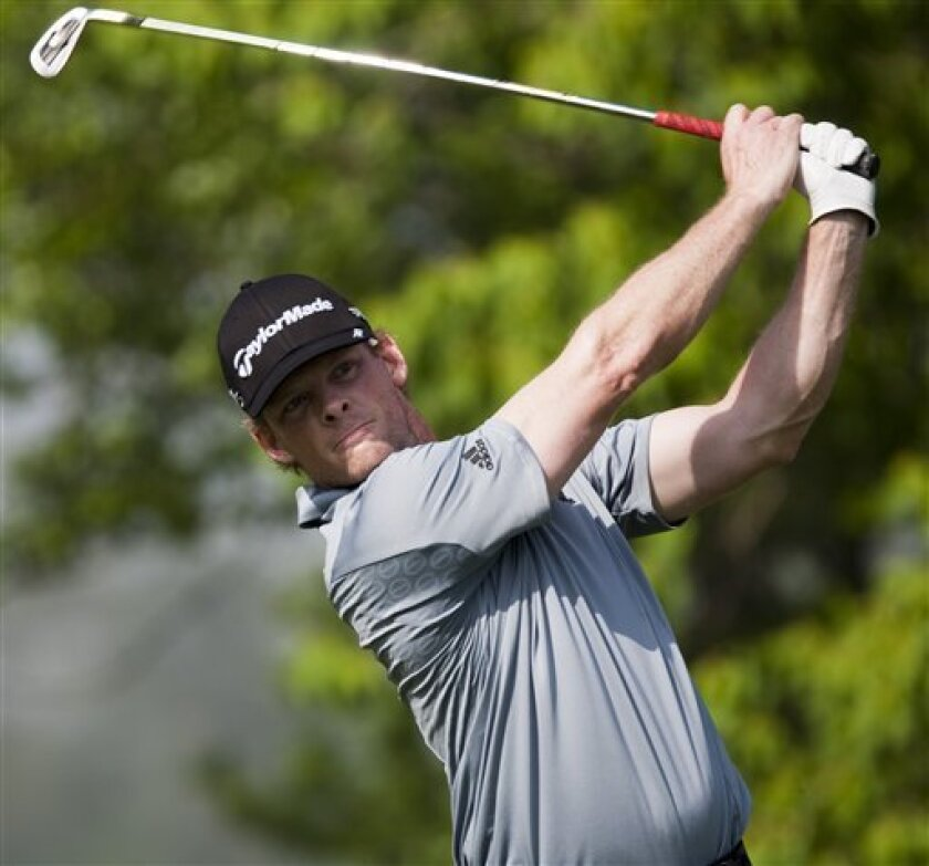 James Driscoll tees off on the ninth hole during the second round of the Houston Open golf tournament, Saturday, March 31, 2012, in Humble, Texas. (AP Photo/Eric Kayne)