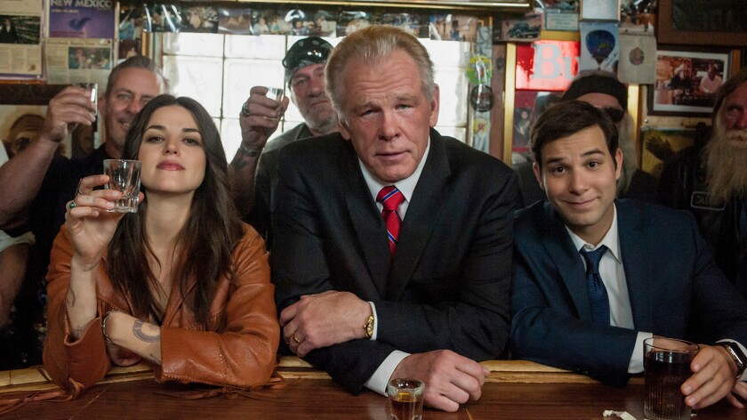 """Nick Nolte, center, plays an ex-president, while Callie Hernandez, left, is his new friend and Skylar Astin his harried keeper in """"Graves,"""" a new comedy from Epix."""