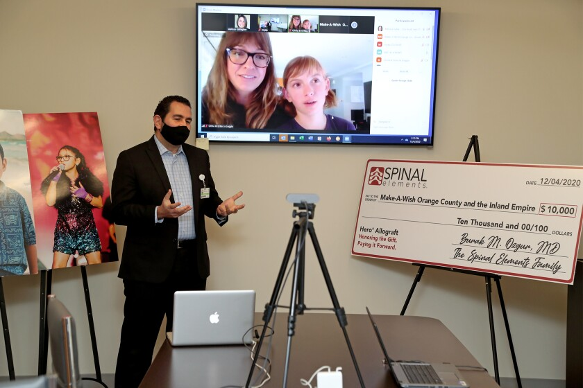 Dr. Burak Ozgur, left, speaks during a Zoom call with Olivia La Loggia, 10, of Huntington Beach, and her mother, Erika.