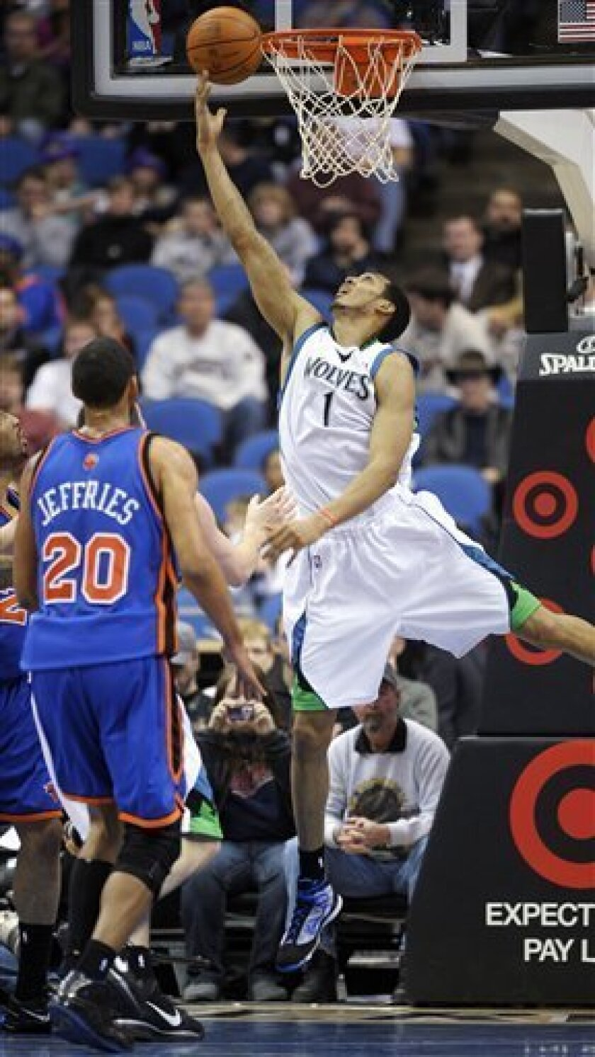 Minnesota Timberwolves center Ryan Hollins (1) goes to the basket as New York Knicks forward Jared Jeffries (20) watches the play during the first quarter of an NBA basketball game Sunday, Jan. 31, 2010, in Minneapolis. (AP Photo/Tom Olmscheid)