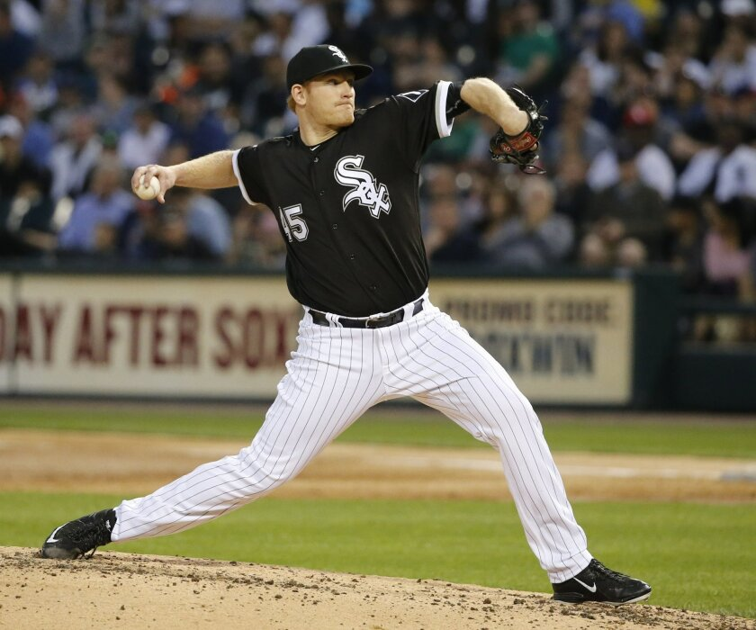 Chicago White Sox starting pitcher Erik Johnson delivers during the second inning of the second baseball game of a double header against the Cleveland Indians on Monday, May 23, 2016, in Chicago. (AP Photo/Charles Rex Arbogast)