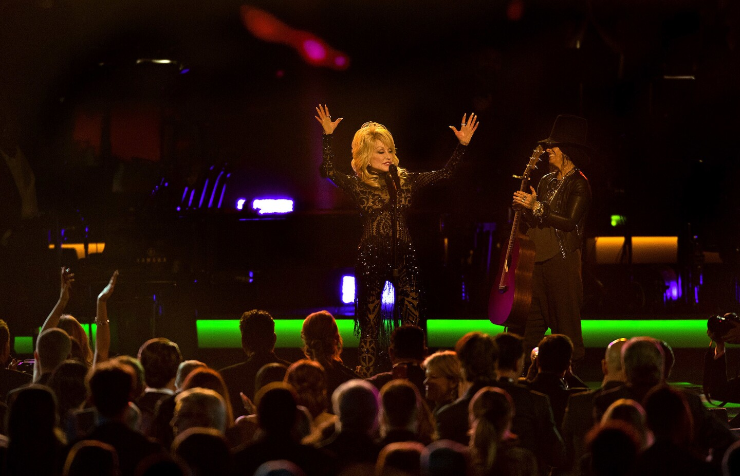 Dolly Parton acknowledges the crowd after performing with Linda Perry.