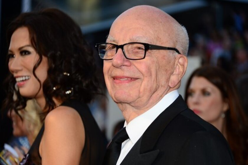 Rupert Murdoch and wife Wendi Deng Murdoch arrive on the red carpet for the 85th Annual Academy Awards earlier this year.