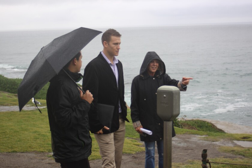 Whale View Point project organizer Ann Dynes (right) with Mauricio Medina and Daniel Orloff, representatives from City Councilmember Barbara Bry's office