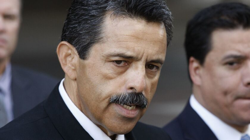 LOS ANGELES , CALIFORNIA - JANUARY 20, 2015: Los Angeles Fire Chief Ralph Terraza (left) speaks at