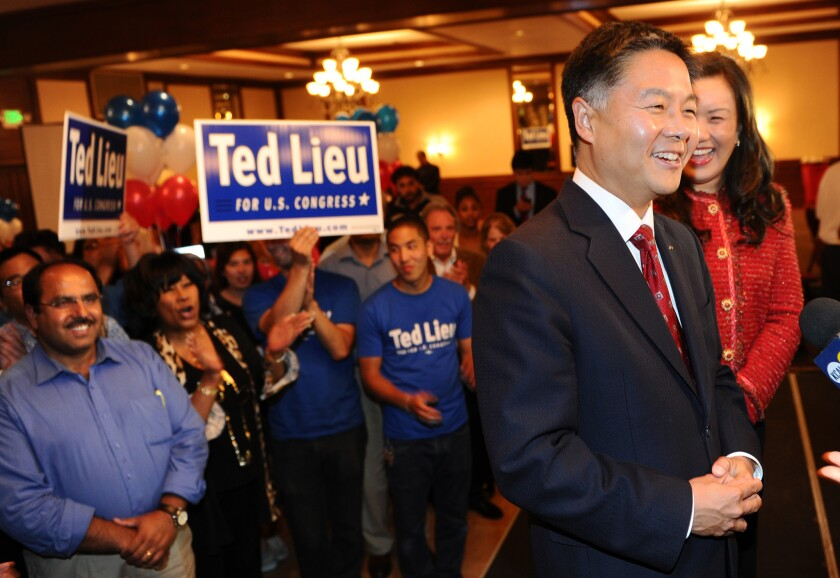 State Sen. Ted Lieu (D-Torrance),joined by his wife, Betty, greets supporters Tuesday night after winning a spot on fall ballot in the race to succeed U.S. Rep. Henry A. Waxman.