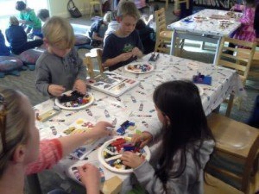 The LEGOs playgroup draws an average of 20 children each week who share ideas and designs.