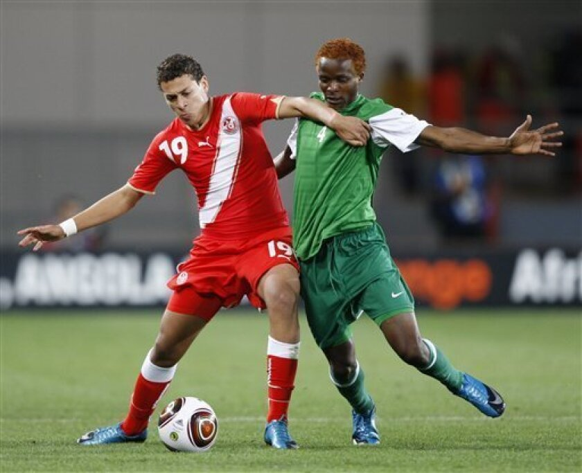 Tunisia's Youssef Msakni, left, is challenged by Zambia's Joseph Musonda during their African Cup of Nations Group D soccer match at Tundavala Stadium in Lubango, Angola Wednesday, Jan. 13, 2010. (AP Photo/Rebecca Blackwell)
