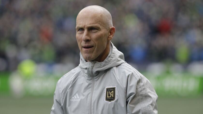 Los Angeles head coach Bob Bradley walks on the pitch before an MLS soccer match against the Seattle