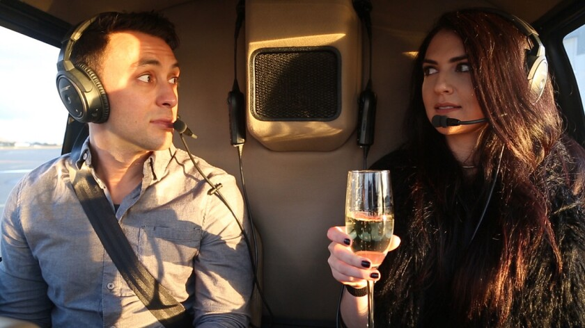 Blind daters Scott Schindler and Zlata Sushchik are surprised as their helicopter takes off. The two were on a Romance Tour provided by Corporate Helicopters.