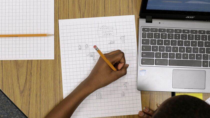 A student works on Common Core math problems as part of a trial state assessment test on Feb. 12, 2015.