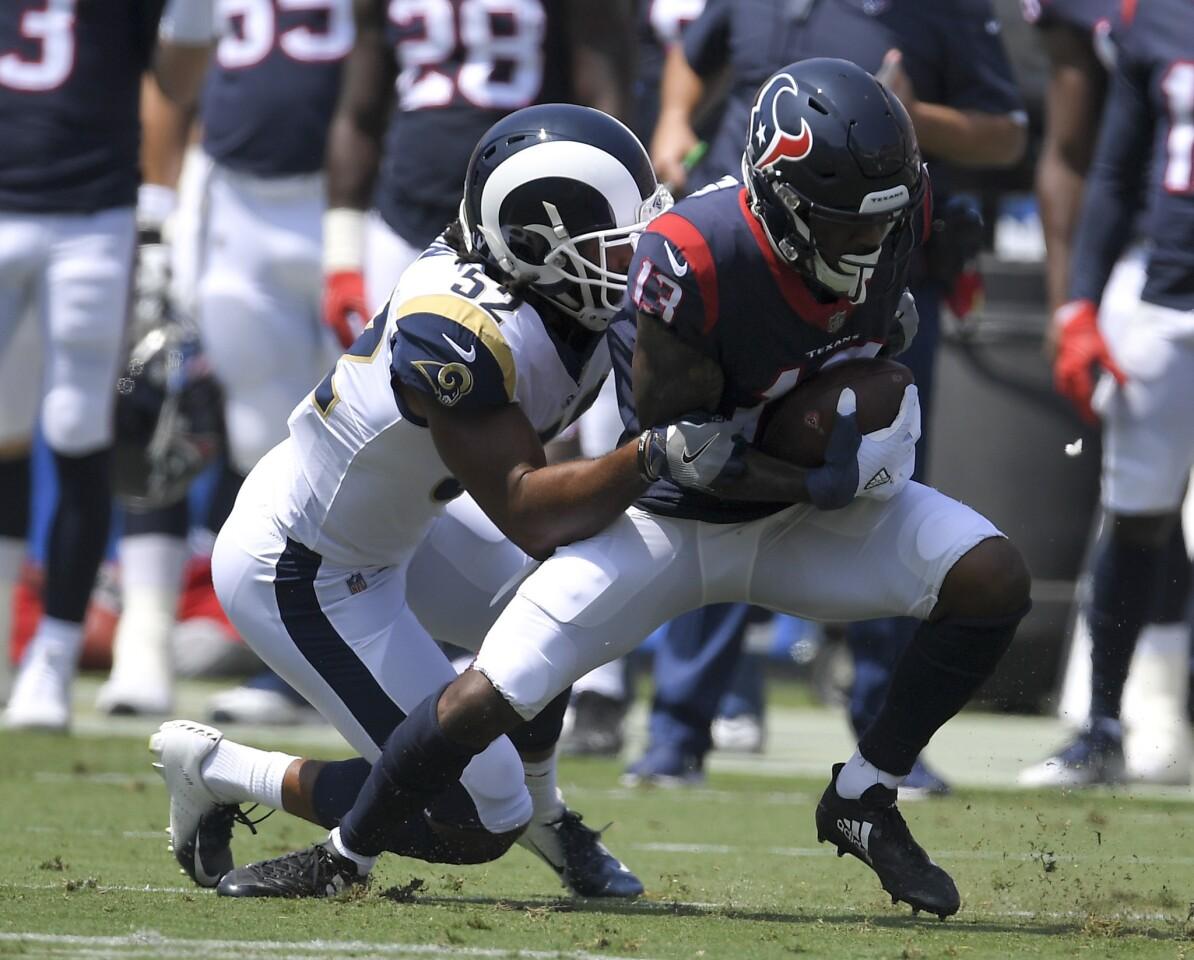 Houston Texans quarterback Deshaun Watson runs against the Los Angeles Rams during the first half in an NFL preseason football game Saturday, Aug. 25, 2018, in Los Angeles. (AP Photo/Mark J. Terrill)