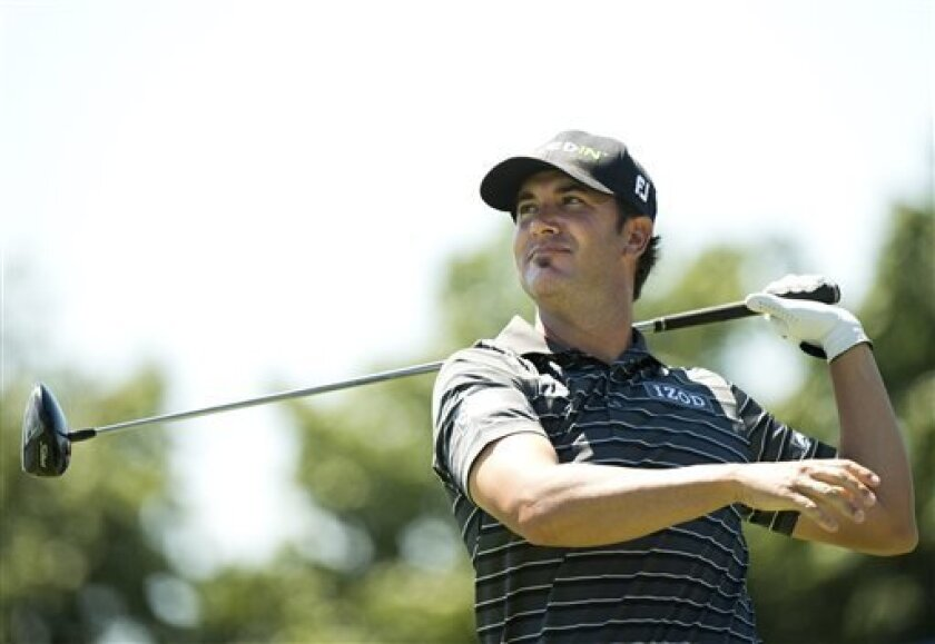 Scott Piercy, of the United States, watches his tee shot on the eighth hole during the first round at the Canadian Open golf tournament at Glen Abbey in Oakville, Ontario, Thursday, July 25, 2013. (AP Photo/The Canadian Press, Nathan Denette)