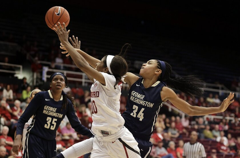 Stanford's Briana Roberson (10) and George Washington's Brianna Cummings (34) fight for a rebound during the second half of an NCAA college basketball game Saturday, Nov. 21, 2015, in Stanford, Calif. (AP Photo/Ben Margot)