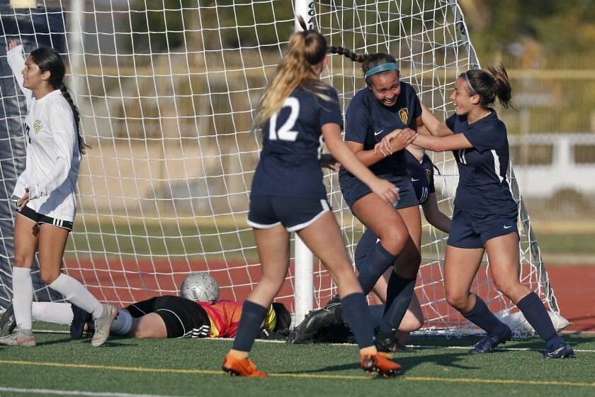 Marina's McKenna Pua, second from right, is congratulated by Renee Mangold, right, and Alexis Van Horn after scoring a goal against Capistrano Valley in the 61st minute of the CIF Southern Section Division 2 quarterfinal playoff match on Feb. 19.