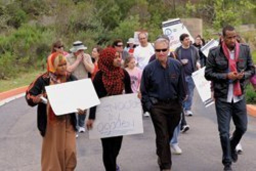 """Participants in the """"Walk to End Genocide"""" on April 22. Photo/Jon Clark"""