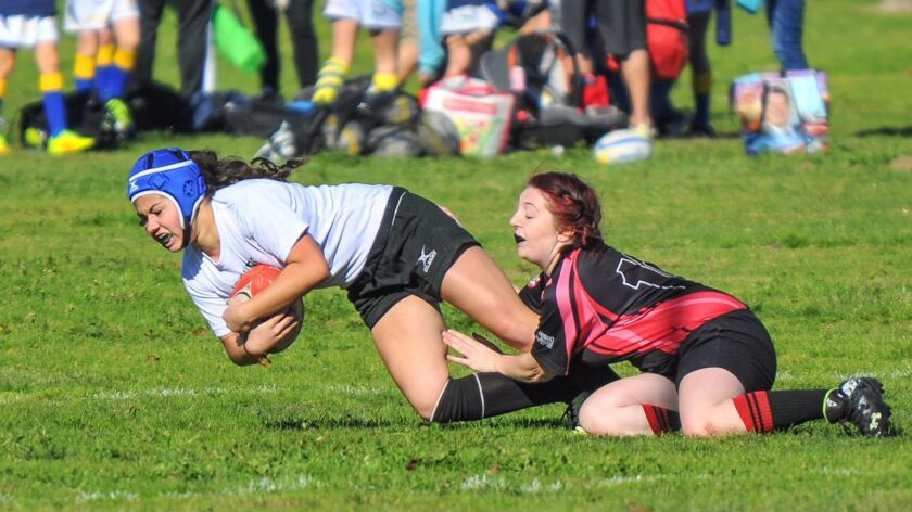 Valley Center's Sophia Rizzotto tries to escape a tackle.
