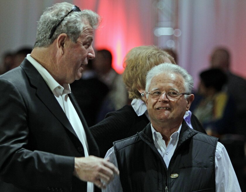 Art Sherman, right, trainer of Kentucky Derby favorite California Chrome, talks with Mike Pegram, left, part owner of second choice Hoppertunity, after the post position draw for the Kentucky Derby horse race at Churchill Downs in Louisville, Ky., Wednesday, April 30, 2014.  (AP Photo/Garry Jones)