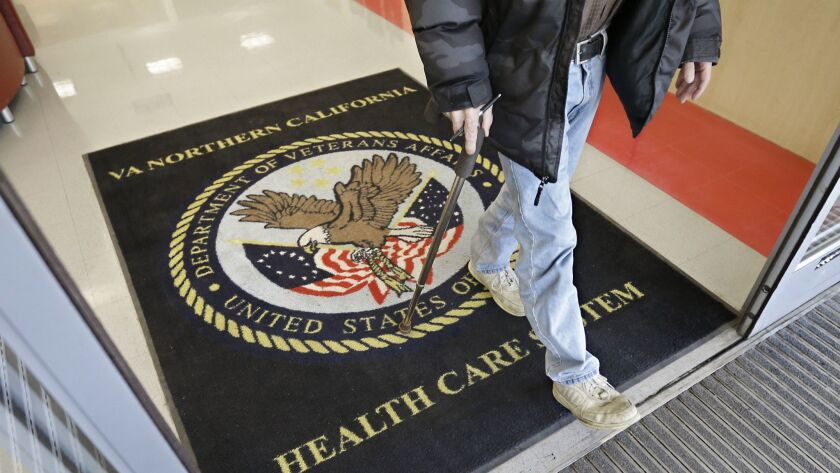 FILE - In this April 2, 2015, file photo, a visitor leaves the Sacramento Veterans Affairs Medical C