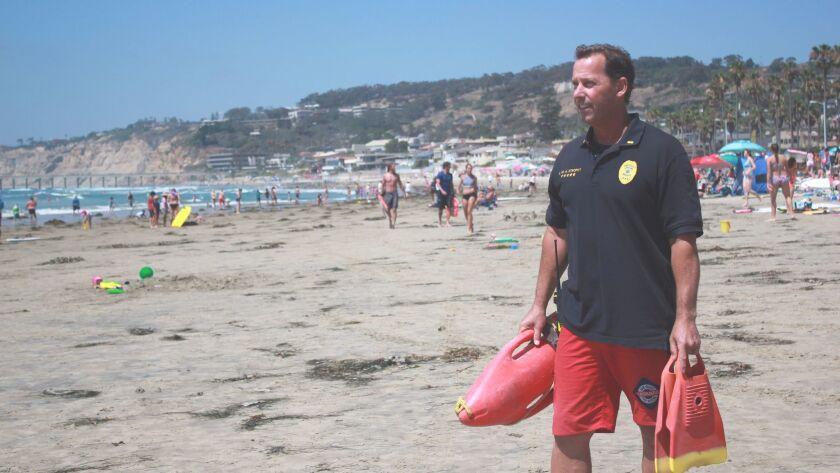 Lifeguard Lieutenant Rich Stropky watches the waves at La Jolla Shores July 20.