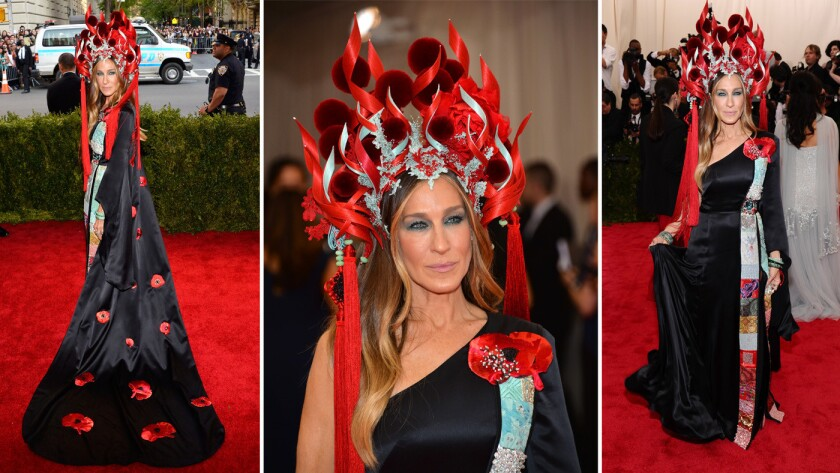Sarah Jessica Parker wears a black satin one-shouldered gown featuring embroidery and embellished with flowers, which was designed in collaboration with H&M and a Philip Treacy headpiece.