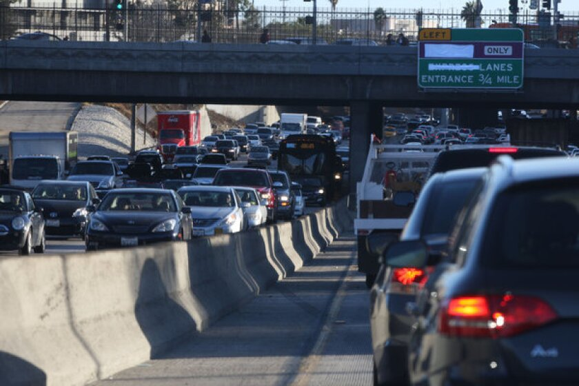 Traffic crawls through downtown Los Angeles on the 110 Freeway. New research shows that in the early morning, air pollution plumes from freeways can travel more than a mile downwind.