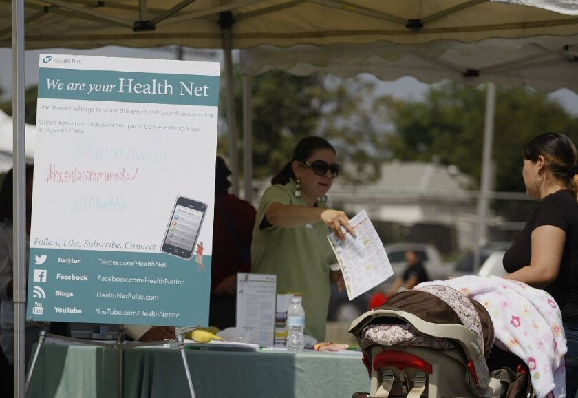 Insurers tell consumers about their new options in the state's health insurance exchange at a recent health fair in East Los Angeles.