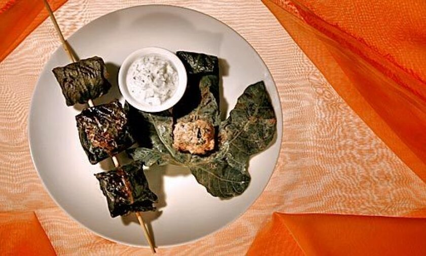 SKEWERED: Fig leaves, with their hints of spice and coconut, are a fragrant wrapper for lamb meatballs.