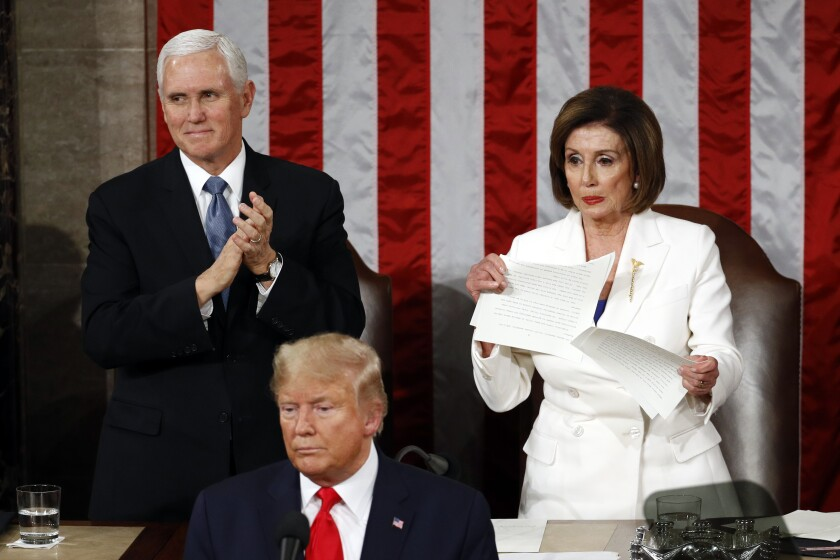 House Speaker Nancy Pelosi rips up her copy of President Trump's State of the Union address after he finished speaking Feb. 4.
