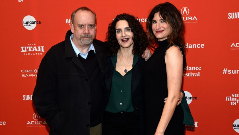 """Tamara Jenkins, center, director of """"Private Life,"""" poses with cast members Paul Giamatti, left, and Kathryn Hahn at the premiere of the film on the opening night of the Sundance Film Festival on Jan. 18 in Park City, Utah."""
